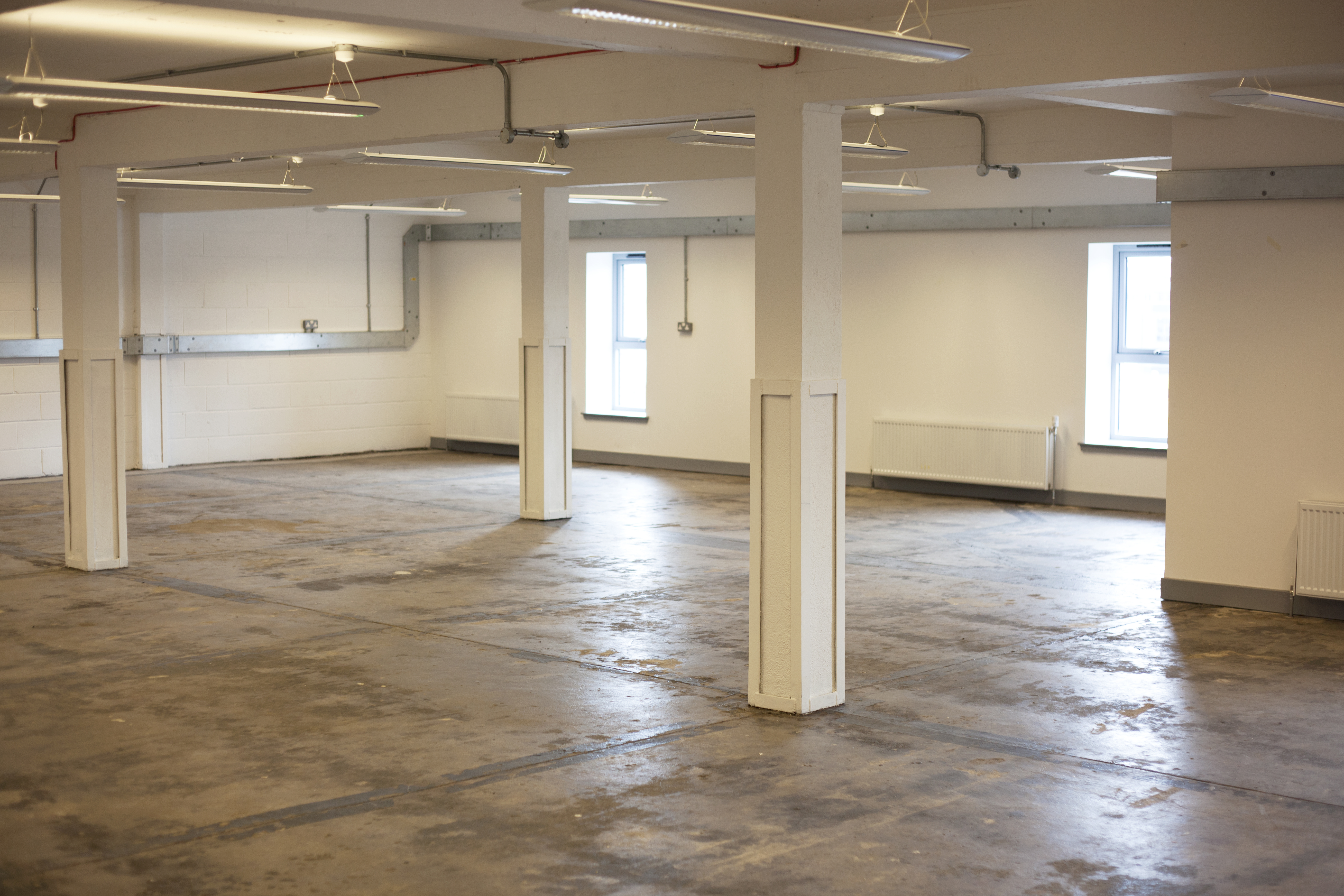 large office space. thanks to the industrial nature of whisky bond building these huge spaces are rented out effectively as blank canvases allowing tenants transform large office space k